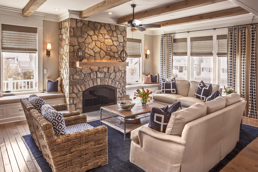 Neutral living room with stone fireplace in Jersey Shore custom home