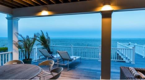 Lighting highlited on deck of custom home on Jersey coastline