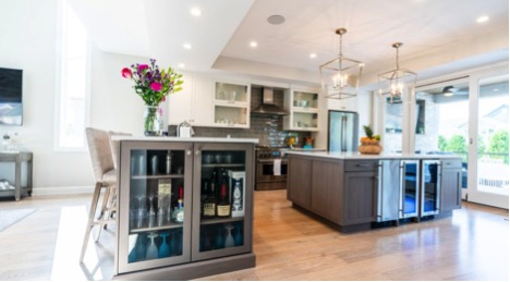 Open airy kitchen with built-in wine fridge in home built by New Jersey custom home builder
