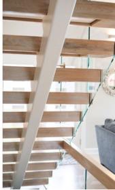 Underside of open staircase used by NJ custom home builder