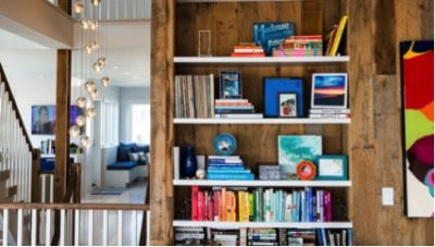 Custom home designer, Bookshelf with books and knick knacks sorted by color and arranged artfully